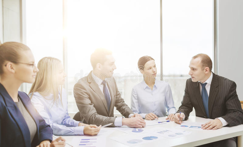 Smiling business team at meeting royalty free stock photos