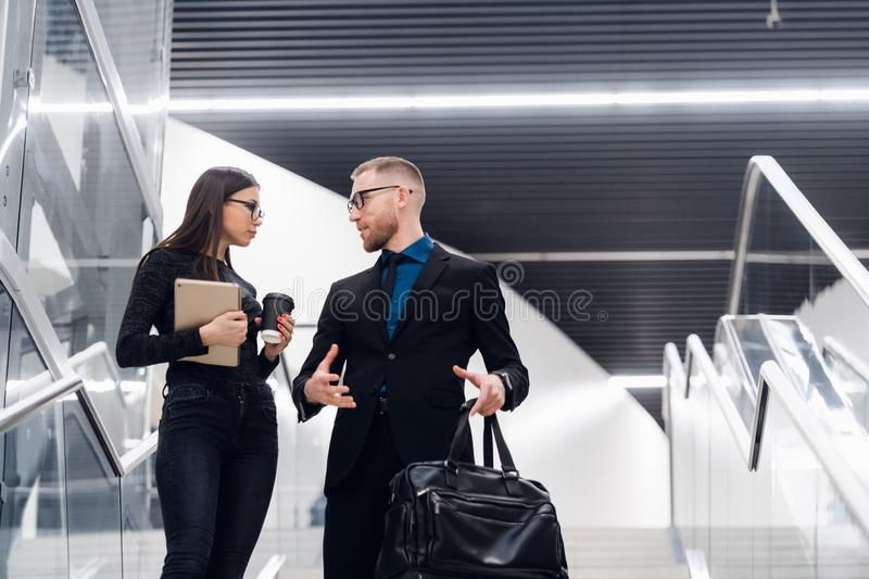 Smiling business team members talking during coffee break, young businessman and businesswoman having pleasant royalty free stock image