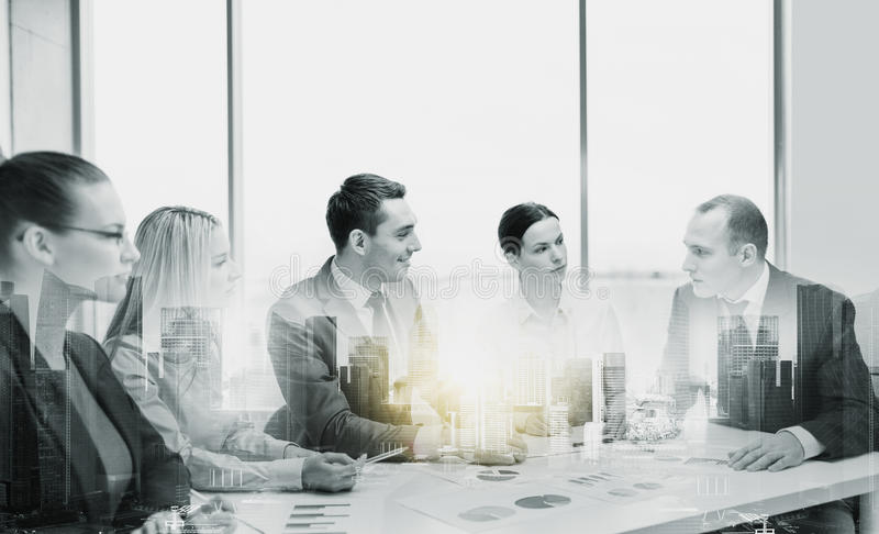 Smiling business team at office meeting royalty free stock images