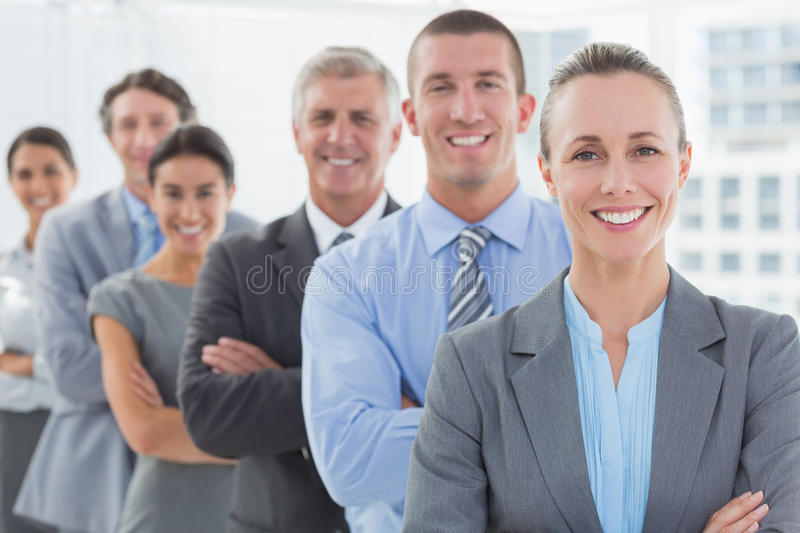 Smiling business team standing in a line royalty free stock images