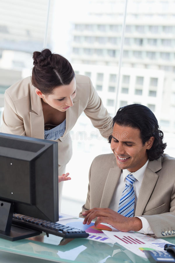 A smiling business team studying statistics stock image