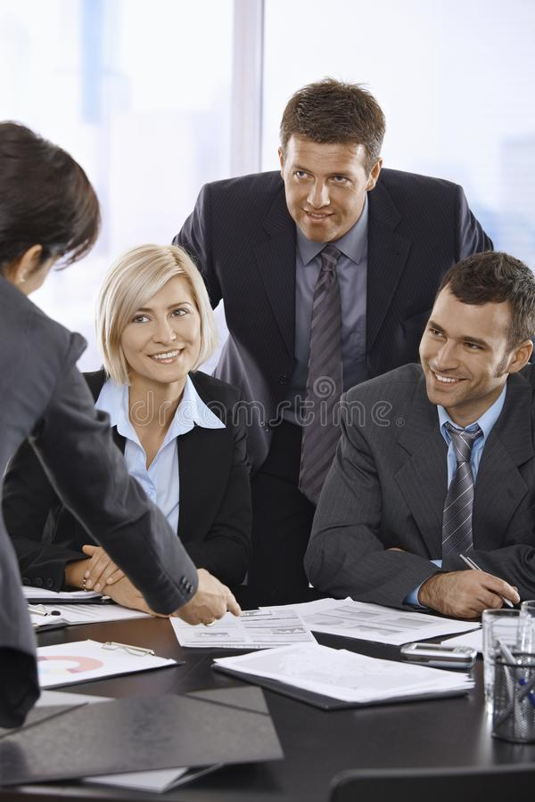 Smiling Business Team Talking In Office Royalty Free Stock Images