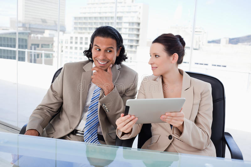 Download Smiling Business Team Using A Tablet Computer Stock Image - Image: 22693953