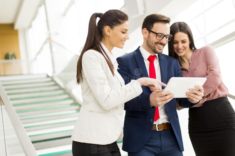 Smiling business team working on tablet royalty free stock photography