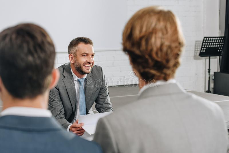 smiling business trainer looking away stock photo