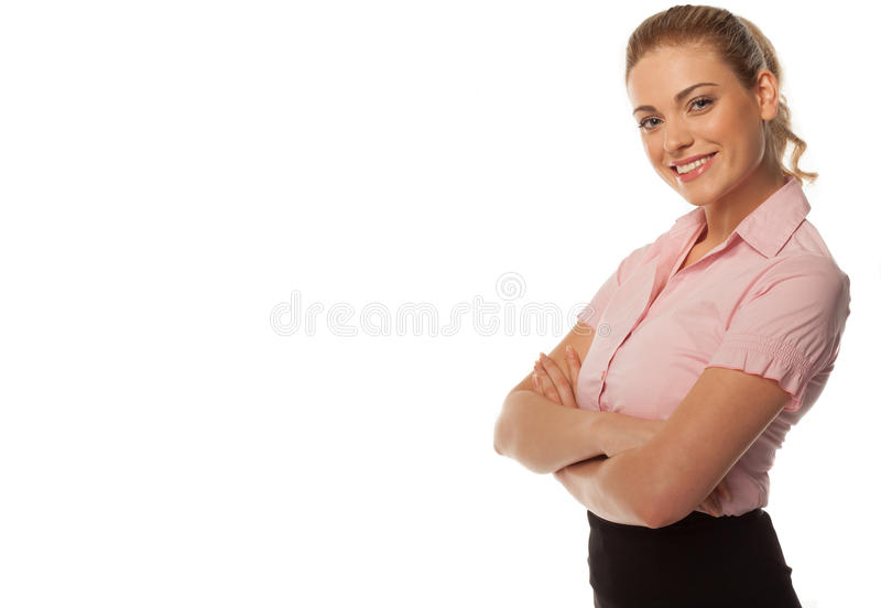 Smiling business woman with arms folded. Studio shot of smiling business woman with arms folded on white background with copy space royalty free stock photography