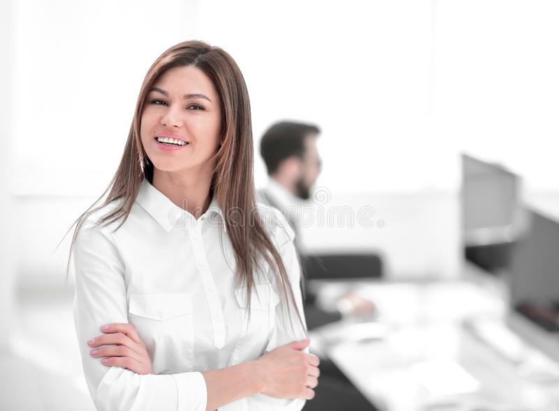 Smiling business woman on the background of the workplace. stock photos