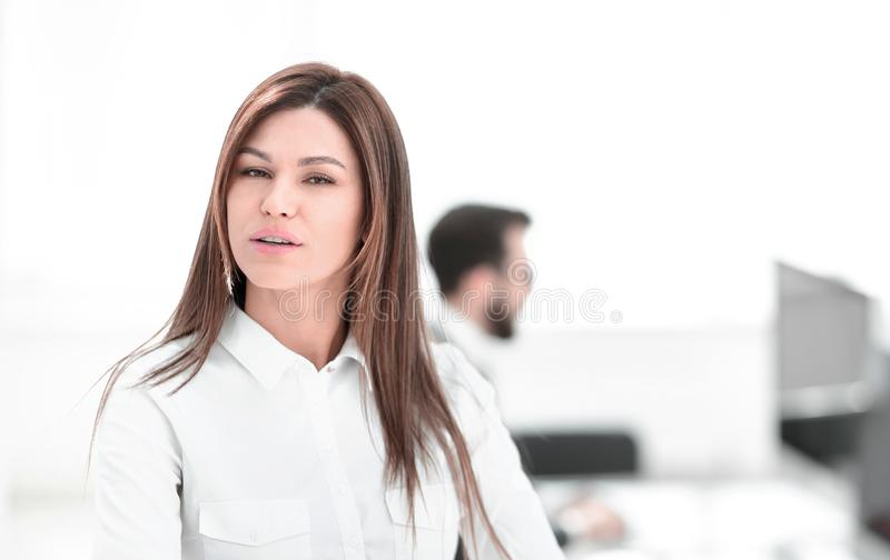 Smiling business woman on the background of the workplace. stock image
