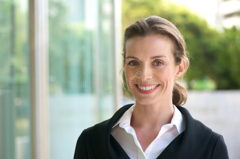 Smiling business woman with black jacket and white shirt royalty free stock photos