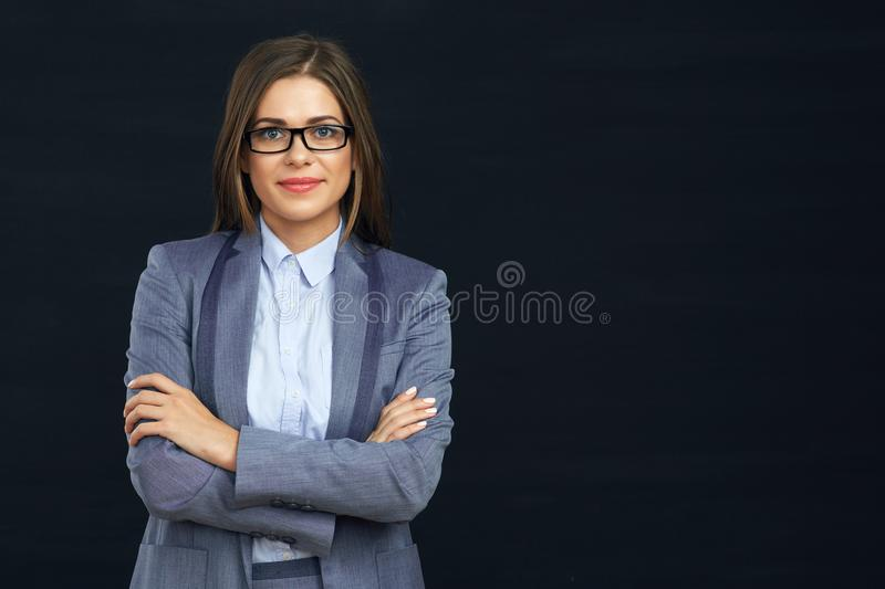 Smiling business woman with eyeglasses crossed arms. Black background isolated stock photos