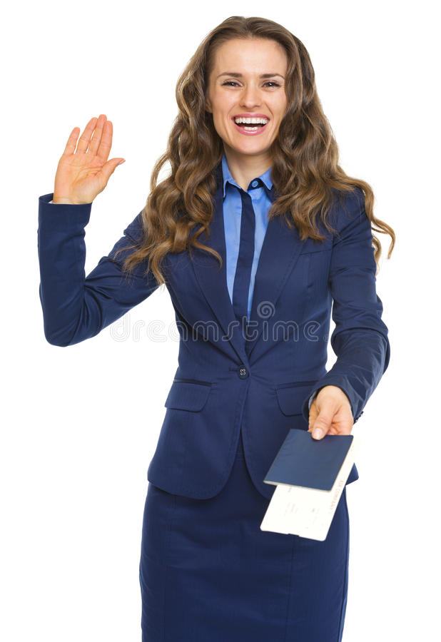Smiling business woman giving passport with air tickets. And goodbye isolated on white royalty free stock image
