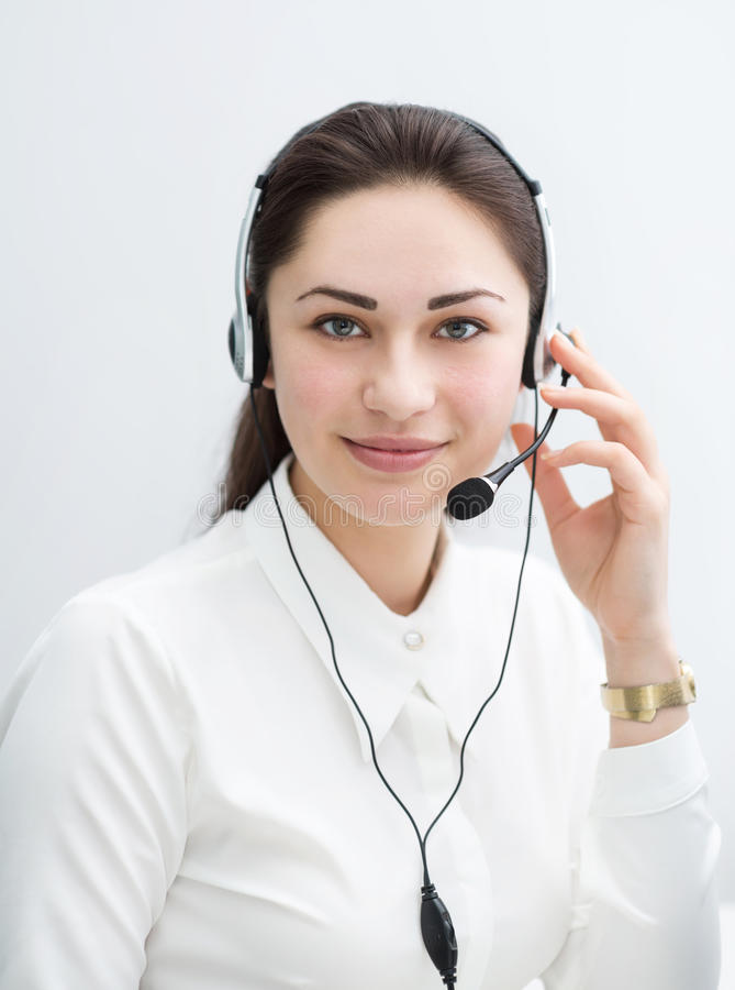 Smiling business woman with headphones looking ahead royalty free stock photos