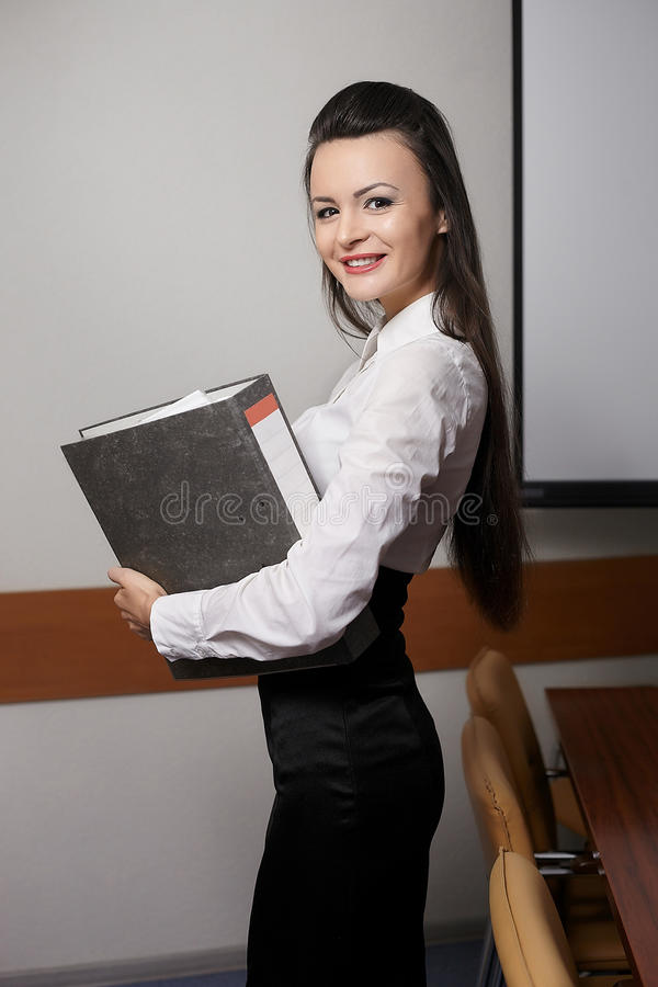 Free Smiling Business Woman In Office With Documents Royalty Free Stock Photo - 23184935