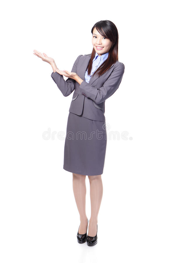 Smiling business woman presenting royalty free stock images