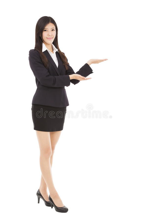 Smiling business woman presenting stock photo