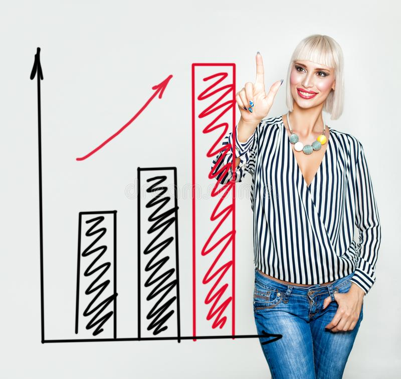 Smiling Business Woman with Red Rising Arrow and Graphs Charts royalty free stock photography