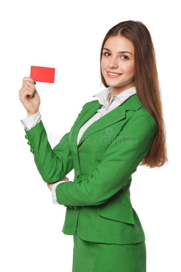 Smiling business woman showing blank credit card in green suit, isolated over white background.  royalty free stock photos