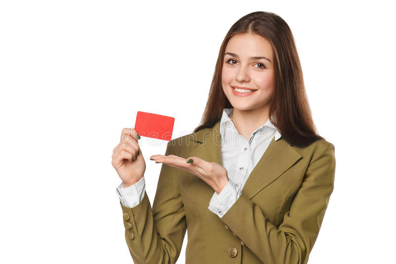 Smiling business woman showing blank credit card in green suit, over white background.  stock photography