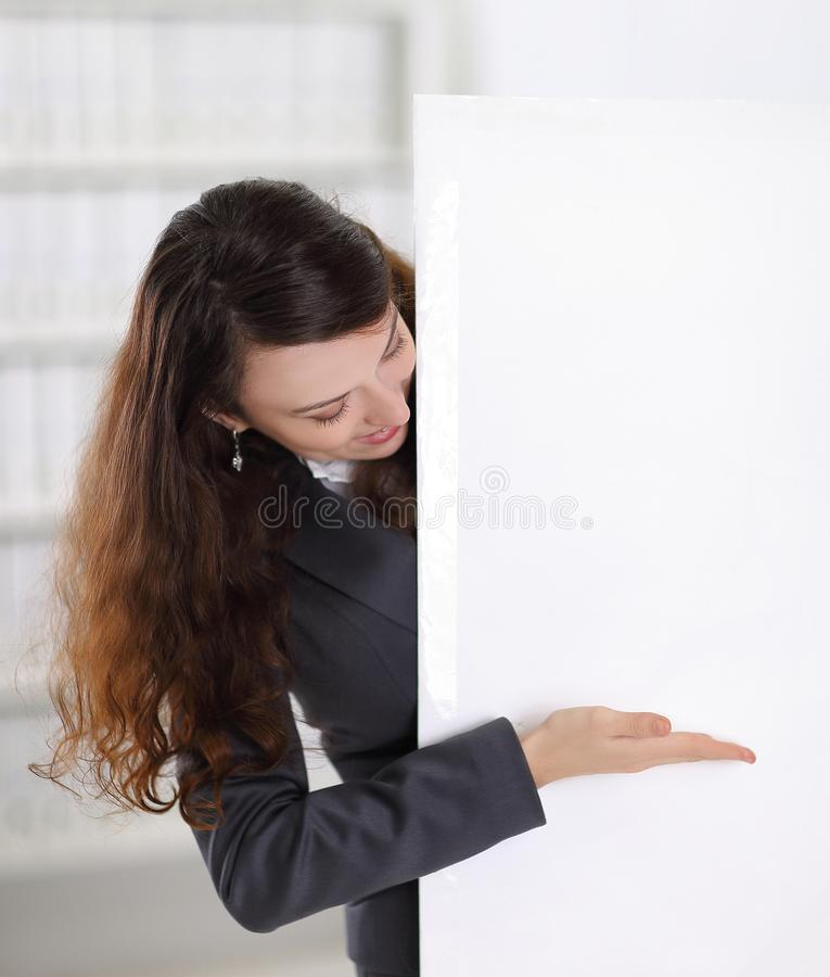 Smiling business woman showing at blank poster. Photo with copy space royalty free stock photos