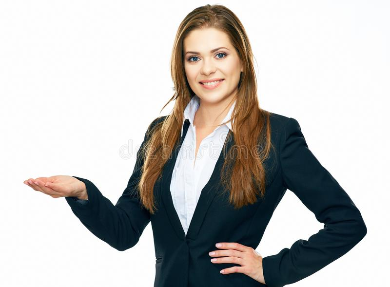 Smiling business woman showing copy space for product or advert. Ising text . isolated on white background royalty free stock photography