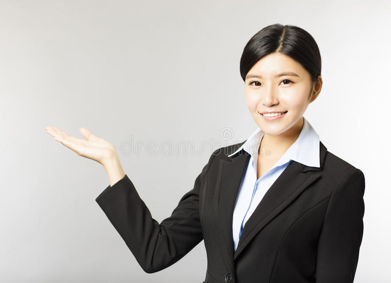 Smiling business woman with showing gesture stock image