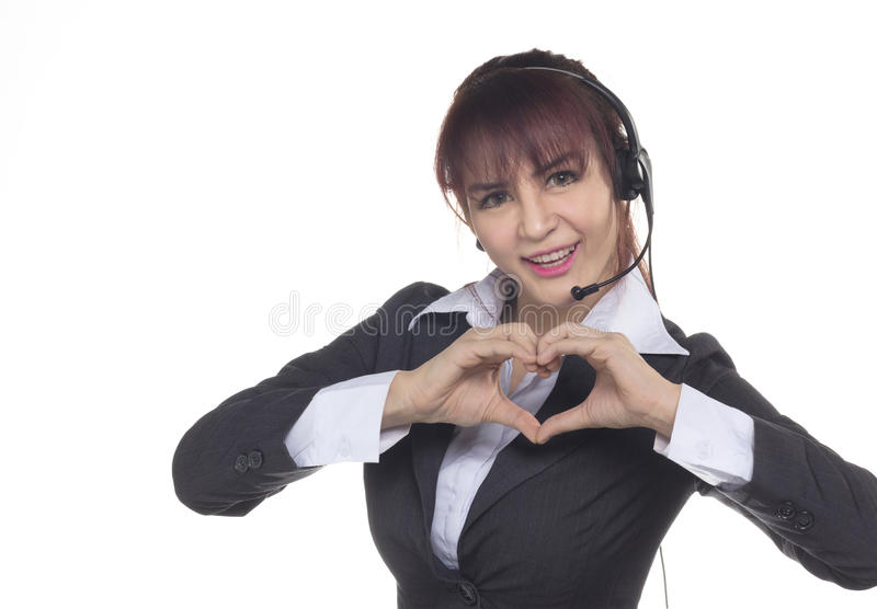 Smiling Business woman showing hand in love sign, heart shape. C. Call center woman, smiling business woman, customer Service Agent with headset isolated on a stock photos