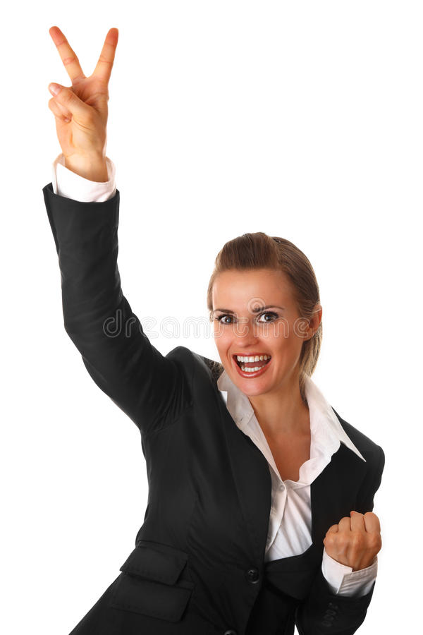 Smiling business woman showing victory gesture. Smiling modern business woman showing victory gesture isolated on white stock images