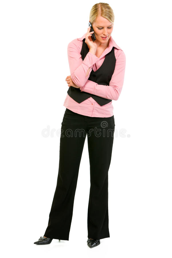Smiling business woman talking on mobile phone