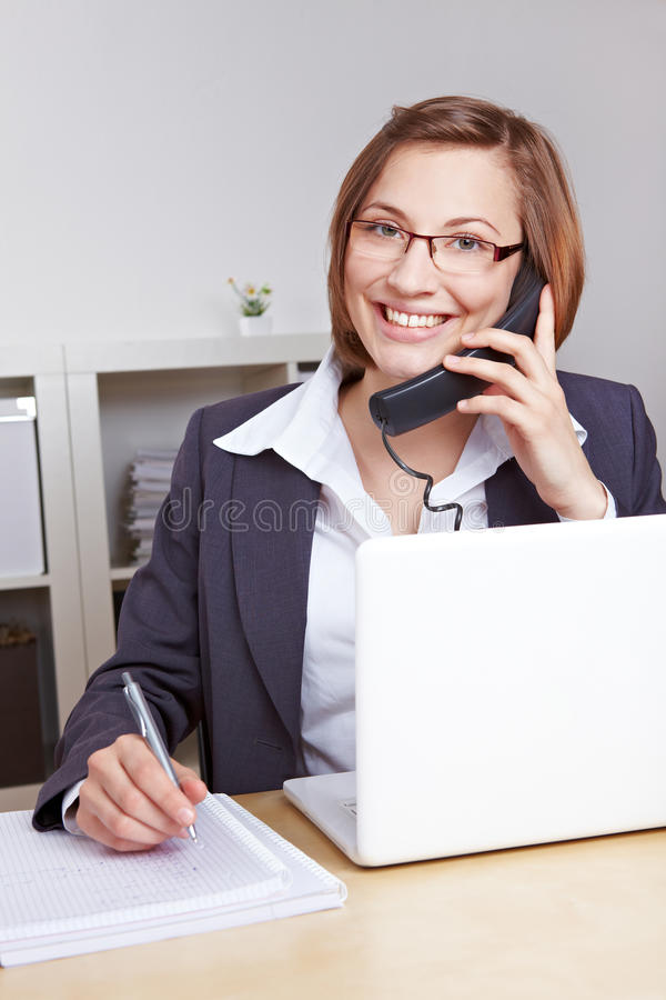 Smiling business woman talking on phone royalty free stock photo
