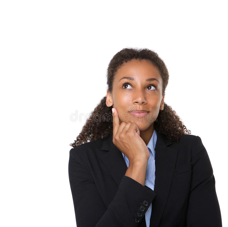 Smiling business woman thinking. Close up portrait of a smiling business woman thinking on isolated white background royalty free stock photography