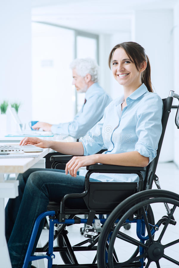 Smiling business woman in wheelchair stock images