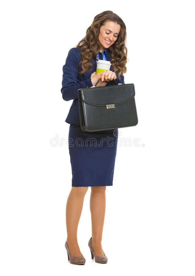 Free Smiling Business Woman With Briefcase And Cofee Cup Looking Time Royalty Free Stock Photos - 32104368