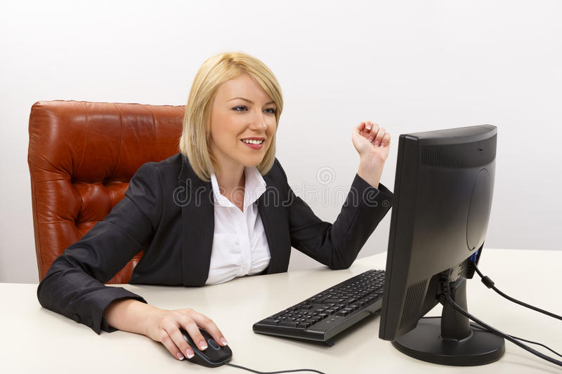 Smiling business woman at work royalty free stock image