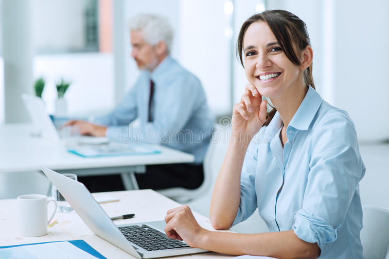 Smiling business woman at work stock photography