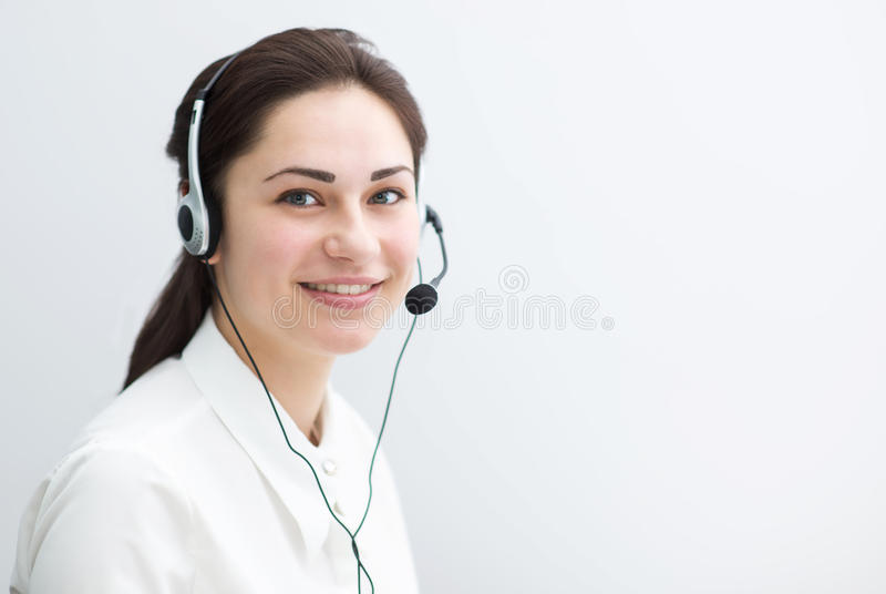 Smiling business woman working in a call center royalty free stock photography