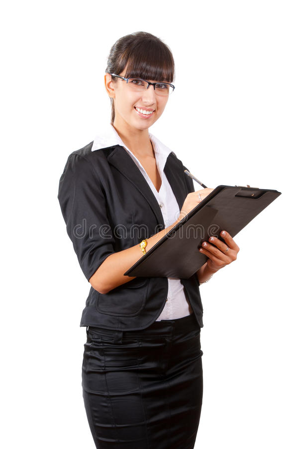Smiling business woman writing royalty free stock images