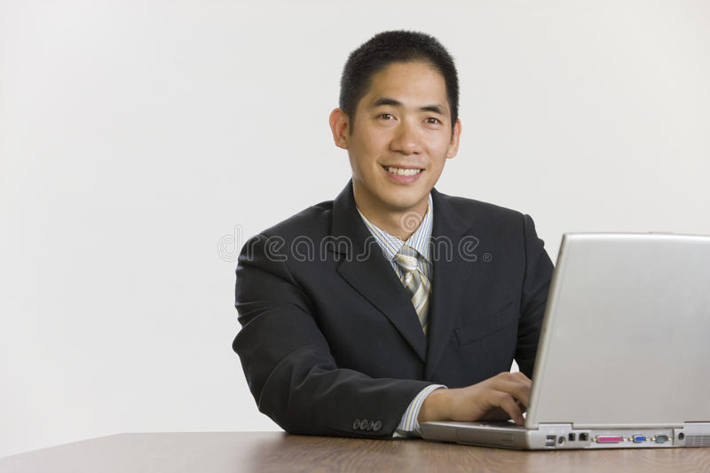 Download Smiling businessman stock photo. Image of asian, laptop - 10947112