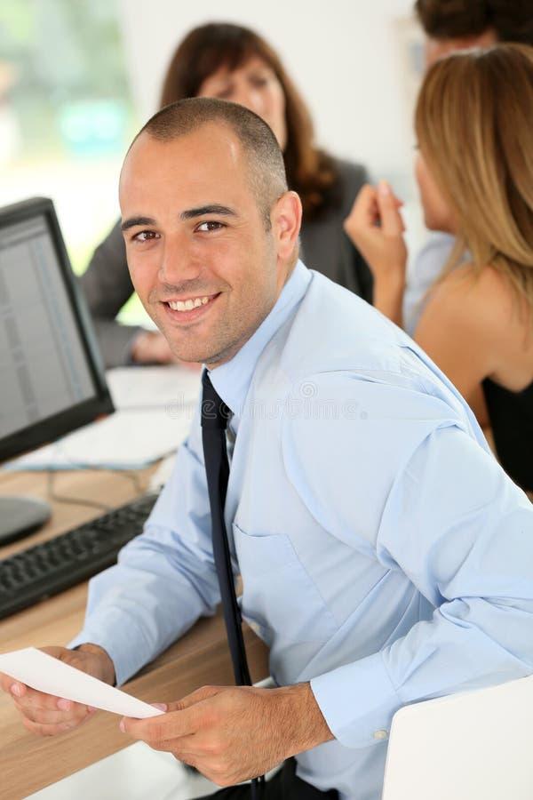 Smiling businessman attending meeting stock photos