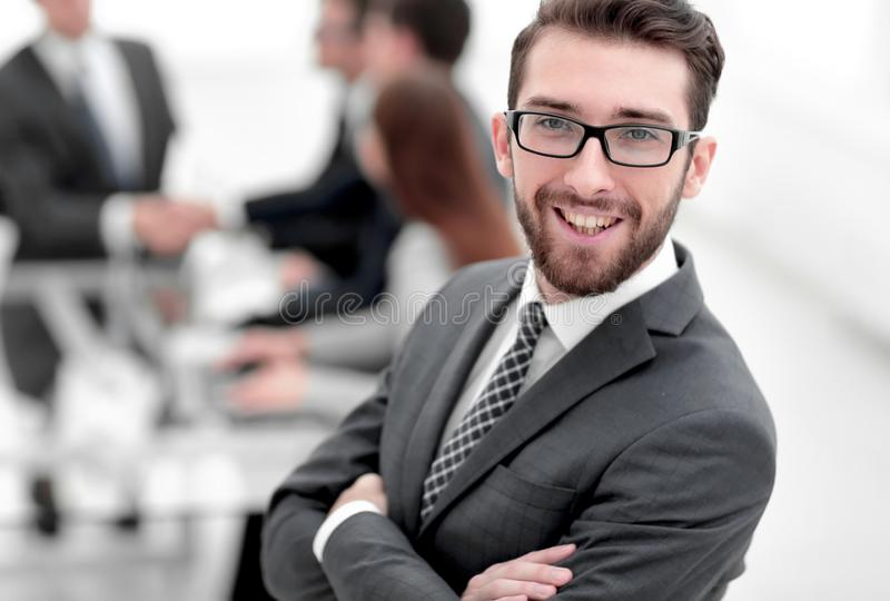 Smiling businessman on background of office.  royalty free stock photo