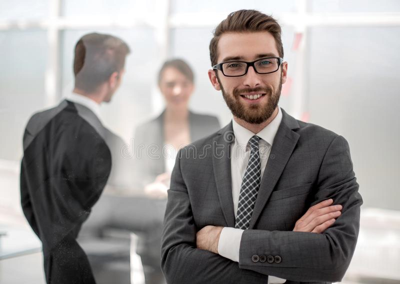 Smiling businessman on the background of the office stock photos
