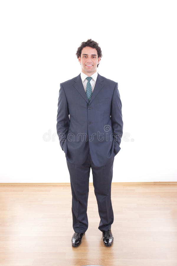 Smiling businessman in black suit casual poses at studio stock images