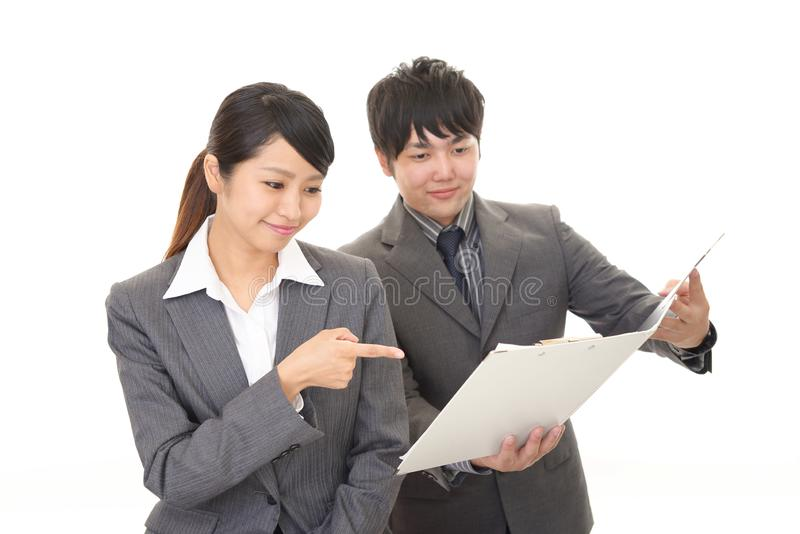 Smiling businessman and businesswoman. Businessman and businesswoman discussing plans royalty free stock photography