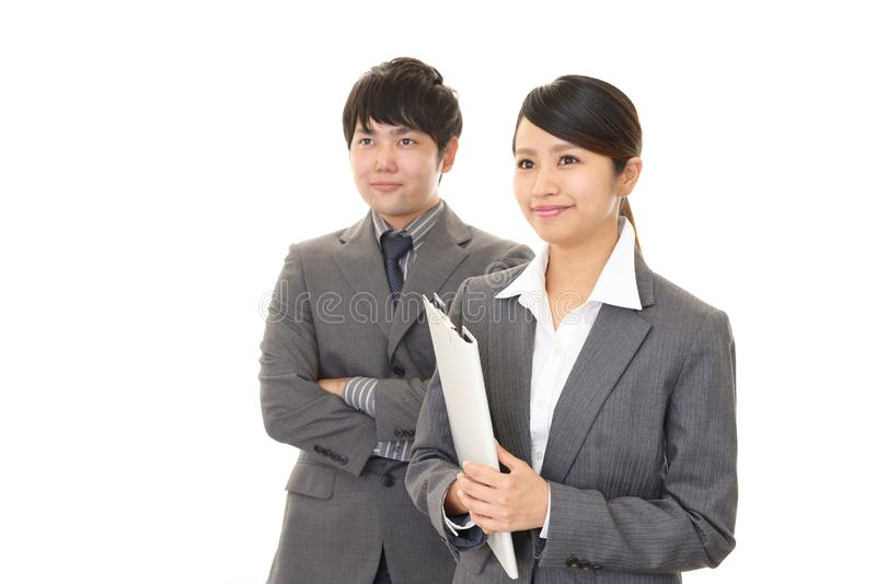 Smiling businessman and businesswoman. Portrait of Asian business people in their office stock photography