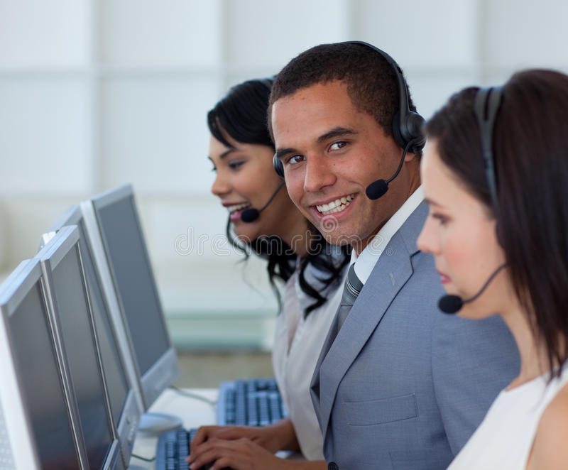 Smiling businessman in a call canter royalty free stock photography