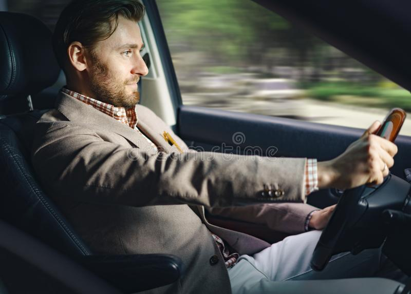 Smiling businessman in car stock images