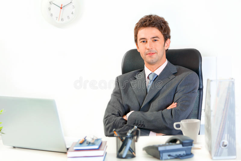Smiling businessman with crossed arms on chest royalty free stock photo