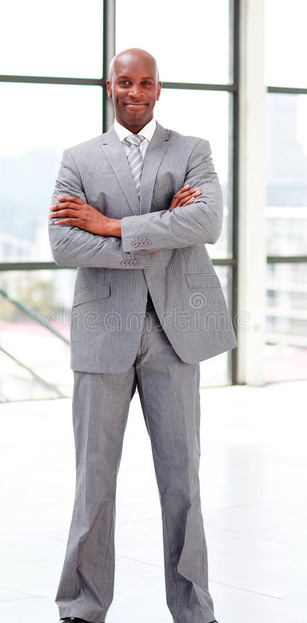 Smiling businessman with folded arms. Looking at the camera stock images