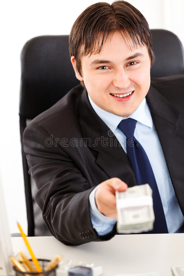 Download Smiling Businessman Giving Dollar Pack Stock Image - Image: 18197251