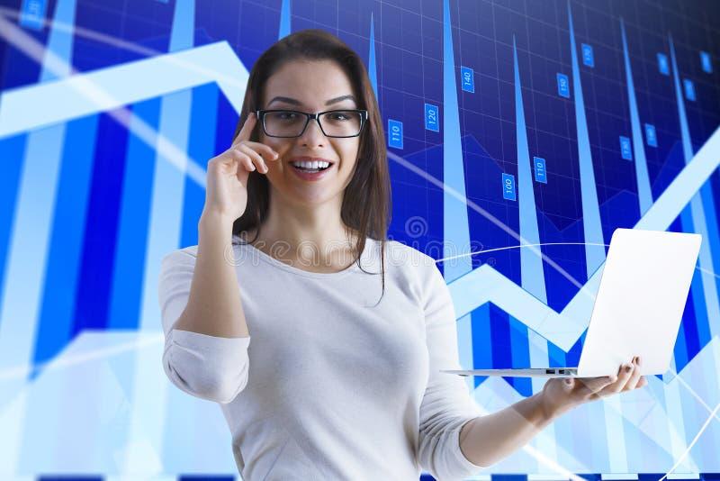 Stock market graphs & woman royalty free stock photo
