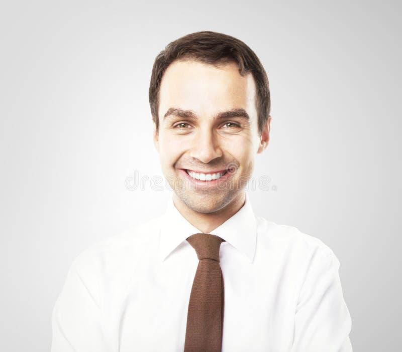 Smiling businessman. On gray background stock image